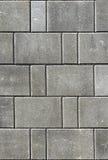 Hårdna eller lappa gråa trottoartjock skiva eller stenar för golv som är wal arkivfoto