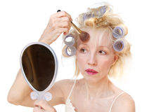hårrullekvinna arkivfoto