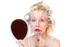 hårrulleseriekvinna arkivfoton