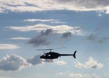 Hélicoptère dans les nuages Photo stock