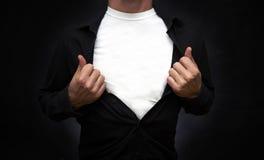 Héroe que muestra la camiseta blanca Fotos de archivo