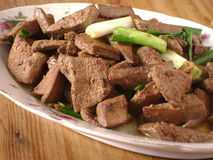 Hígado y cebolla fritos de cerdo Foto de archivo libre de regalías