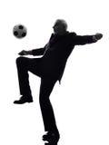 Hög affärsman som spelar fotbollkonturn arkivbild