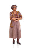 Hög afrikansk kvinna som ser upp Arkivfoto