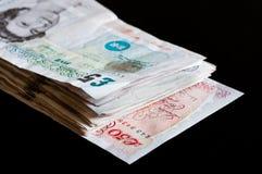 Hög av affären och finans för gbp för ett pund sterling för brittiska pund för pengar Royaltyfria Bilder
