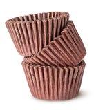 Hög av bruna pappers- koppar för stekheta muffin Royaltyfria Foton