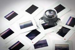Hög av den gamla glidbanan med loupen fotografering för bildbyråer