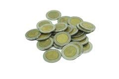 Hög av det thailändska myntet för tio bad Arkivfoton