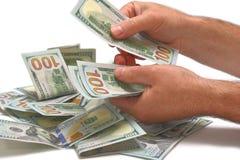 Hög av dollar som räknar Royaltyfria Bilder