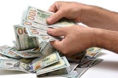 Hög av dollar som räknar Arkivbilder