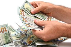 Hög av dollar som räknar Fotografering för Bildbyråer