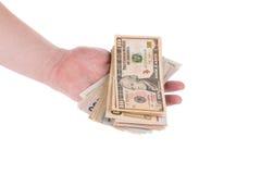 Hög av dollarsedlar i hand Arkivbilder
