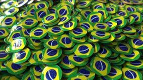 Hög av emblem som presenterar flaggor av Brasilien framförande 3d fotografering för bildbyråer