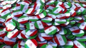 Hög av emblem som presenterar flaggor av Iran framförande 3d arkivfoton