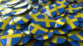 Hög av emblem som presenterar flaggor av Sverige framförande 3d fotografering för bildbyråer