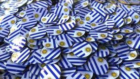 Hög av emblem som presenterar flaggor av Uruguay, tolkning 3D fotografering för bildbyråer