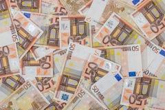 hög av euro 50 som bakgrund Arkivfoton
