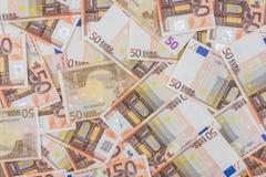 hög av euro 50 som bakgrund Fotografering för Bildbyråer