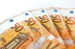 Hög av euro 50 som bakgrundsslut upp Royaltyfri Bild
