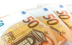 Hög av euro 50 som bakgrundsslut upp Arkivfoton