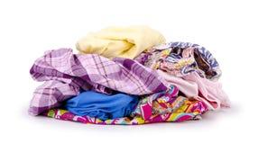 Hög av färgrik kläder som isoleras på vit Royaltyfria Bilder