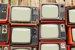 Hög av gammal röd retro TV Royaltyfri Fotografi