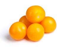 Hög av gula tomater Arkivfoto