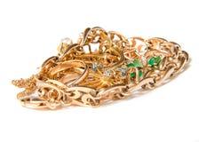 hög av guld- smycken Arkivbild
