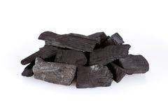 Hög av kol som isoleras på vit fotografering för bildbyråer