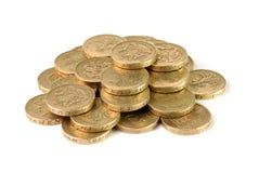 Hög av mynt för brittiskt pund Arkivbild
