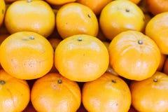 Hög av orange frukt Fotografering för Bildbyråer