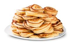 Hög av pannkakor på en roterande vit platta Royaltyfri Bild