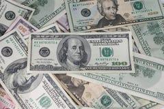 Hög av pengar arkivbild