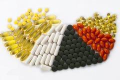 Hög av pills Royaltyfria Bilder