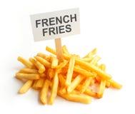 Hög av potatissmåfiskar på kraft papper fransman royaltyfri fotografi