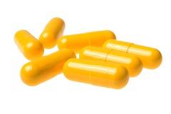 Hög av preventivpillerar som isoleras på vit bakgrund Royaltyfri Foto