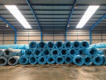 Hög av råvaror i factory'sinventarium royaltyfria foton