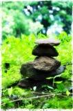 Hög av stenar på vaten Phou arkivfoto