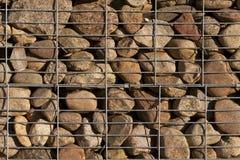 Hög av stenen med metallraster Royaltyfri Fotografi