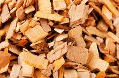 Hög av trä som röker chiper Royaltyfri Fotografi