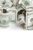 Hög av USD Förenta staternadollar på vit Royaltyfria Bilder