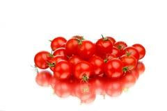 Hög för körsbärsröda tomater royaltyfri fotografi