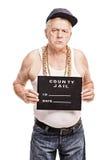 Hög gangster som poserar för ett rånaskott arkivbilder