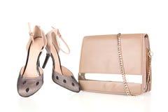 Hög-heeled kängor och läderhandväska Royaltyfri Fotografi