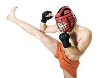 hög kick för konst som kikboxing krigs- sidoutbildning Arkivfoto
