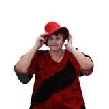 Hög kvinna i röd hatt royaltyfria foton