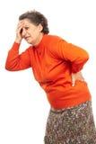 Hög kvinna med ryggvärk Royaltyfri Foto