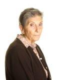 Hög kvinna på ledset uttryck för vit bakgrund Royaltyfri Bild