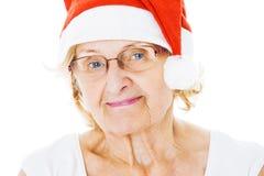Hög kvinna som bär Santa Hat Over White Background Royaltyfri Fotografi