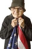 Hög kvinna som rymmer en amerikanska flaggan Arkivfoto